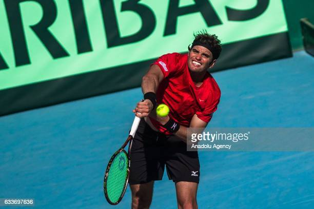 Malek Jaziri of Tunisia returns the ball to Isak Arvidsson of Sweden during their second round doubles match of the Davis Cup's Europe and Africa...