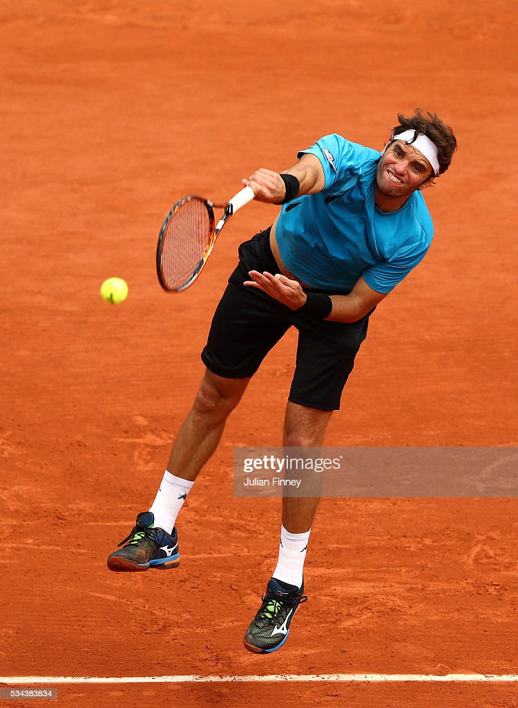 <a gi-track='captionPersonalityLinkClicked' href=/galleries/search?phrase=Malek+Jaziri&family=editorial&specificpeople=7532169 ng-click='$event.stopPropagation()'>Malek Jaziri</a> of Tunisia serves during the Men's Singles second round match against Tomas Berdych of Czech Republic on day five of the 2016 French Open at Roland Garros on May 26, 2016 in Paris, France.