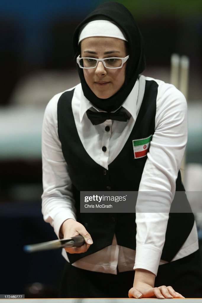 Malekara Aisan of Iran contemplates her shot against Battulga Uyanga of Mongolia during the Billiards, Women's 10 Ball Single Round of 32 Match at Songdo Convensia on day four of the 4th Asian Indoor & Martial Arts Games on July 2, 2013 in Incheon, South Korea.