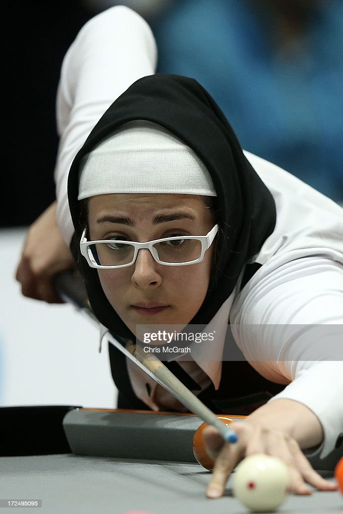 Malekara Aisan of Iran plays a shot against Battulga Uyanga of Mongolia during the Billiards, Women's 10 Ball Single Round of 32 Match at Songdo Convensia on day four of the 4th Asian Indoor & Martial Arts Games on July 2, 2013 in Incheon, South Korea.