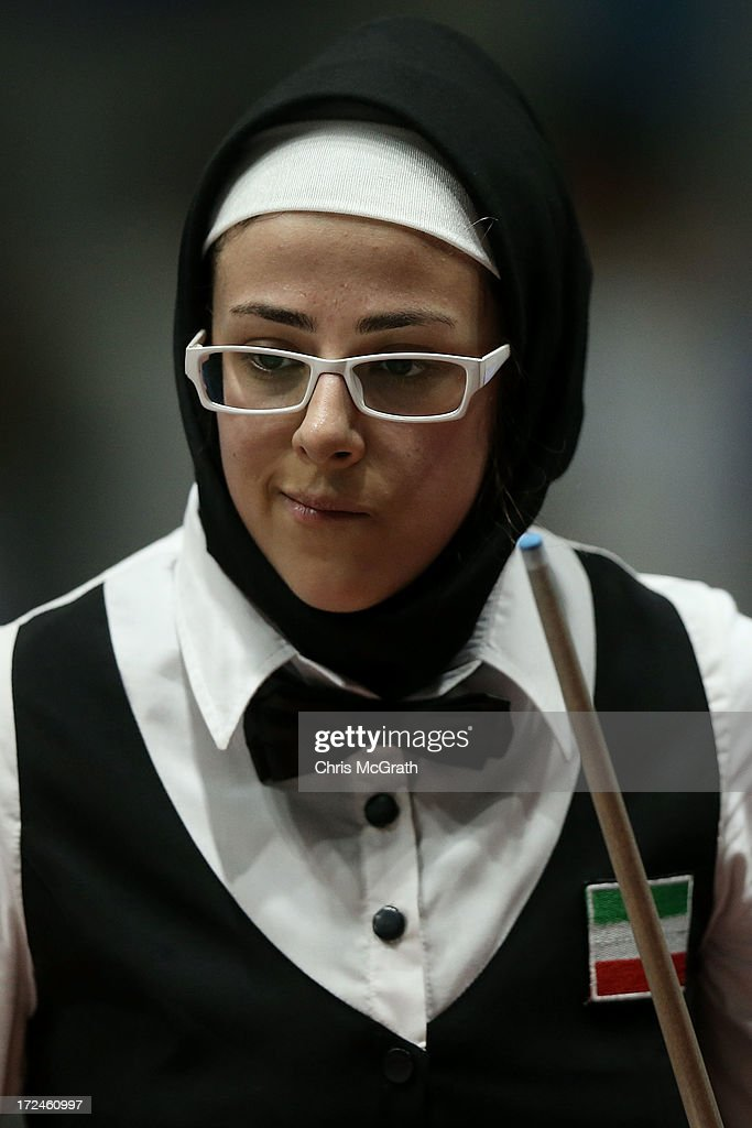 Malekara Aisan of Iran reacts to her shot against Battulga Uyanga of Mongolia during the Billiards, Women's 10 Ball Single Round of 32 Match at Songdo Convensia on day four of the 4th Asian Indoor & Martial Arts Games on July 2, 2013 in Incheon, South Korea.