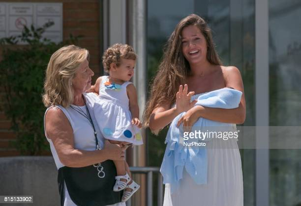 Malena Costa wife of Mario Suárez poses with her son Mario after leaving the hospital in Madrid Spain on 15 July 2017 The model gave birth last July...