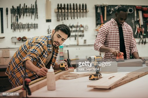 Males carpenters working with tools in  wood shop : Stock Photo