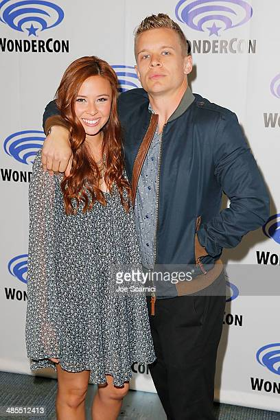 Malese Jow and Jesse Luken attend the Star Crossed press line at WonderCon Anaheim 2014 Day 1 at Anaheim Convention Center on April 18 2014 in...