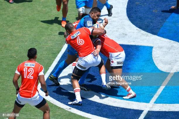 Malgene Ilaua of Sunwolves and Koki Yamamoto of Sunwolves make a takle on OfaTuÕungafasi of Blues during the Super Rugby match between the Sunwolves...