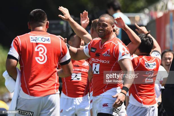 Malgene Ilaua of the Sunwolves celebrates with team mates during the Super Rugby match between the Sunwolves and the Blues at Prince Chichibu Stadium...