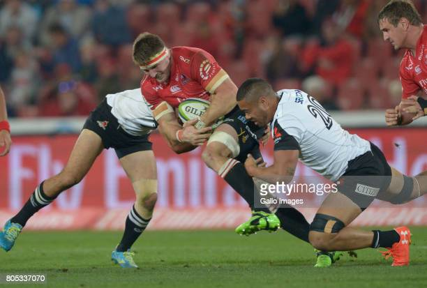Malgene Ilaua of the Sunwolves tackles Captain Jaco Kriel of the Lions during the Super Rugby match between Emirates Lions and Sunwolves at Emirates...