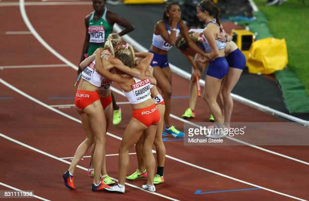 Malgorzata Holub Iga Baumgart Aleksandra Gaworska Justyna Swiety of Poland celebrate winning bronze in the Women's 4x400 Metres Relay final during...