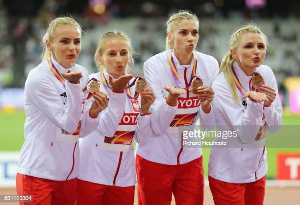 Malgorzata Holub Iga Baumgart Aleksandra Gaworska Justyna Swiety of Poland bronze pose with their medals for the Women's 4x400 Metres Relay final...