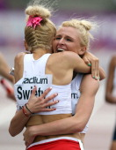 Malgorzata Holub of Poland is congratulated by her team mate Justyna Swiety after Poland win the Women's 4x400m Final during day four of The European...
