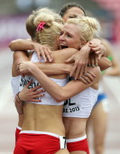 Malgorzata Holub of Poland is congratulated by her team mates after Poland win the Women's 4x400m Final during day four of The European Athletics U23...