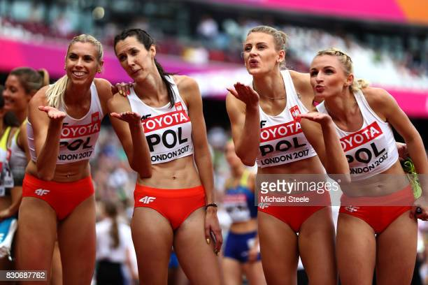 Malgorzata Holub Patrycja Wyciszkiewicz Martyna Dabrowska and Iga Baumgart of Poland react after compteing in the Women's 4x400 Metres Relay heats...