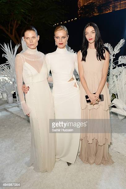 Malgosia Bela Eva Herzigova and Mariacarla Boscono attend the Gala event during the Vogue Fashion Dubai Experience 2015 at Armani Hotel Dubai on...