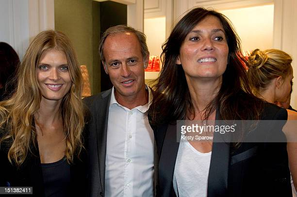 Malgosia Bela Xavier Romatet and Emmanuelle Alt attend Vogue Fashion Night Out 2012 on September 6 2012 in Paris France