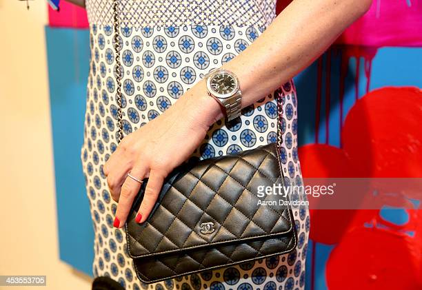 Malgosia wearing a Stella McCartney dress Chanel bag and Rolex watch attends Art Basel Miami Beach 2013 at the Miami Beach Convention Center on...