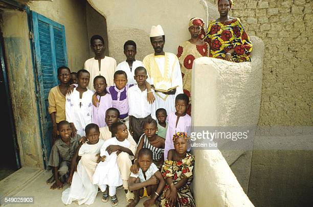 An islamic marabout with his two wives and children