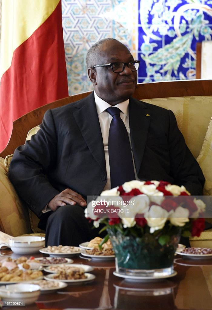 Mali president Ibrahim Boubacar Keita smiles during a meeting with President of the Algerian Senate, Abdelkader Bensalah (UNSEEN), in the capital Algiers on March 22, 2015.