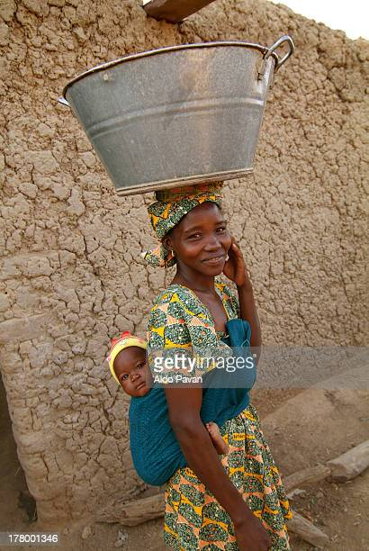 Mali, Segou, Bamara village, woman with baby