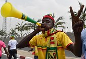 A Mali supporter gestures and blows a vuvuzela horn upon the arrival of Mali's team at Malabo airport on January 16 ahead of the 2015 Africa Cup of...