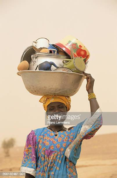 Mali, Timbuktu, Songhai woman carrying dishes on head, portrait