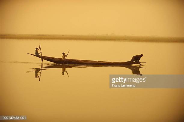 Mali, Timbuktu, three Songhai people in boat on the Niger
