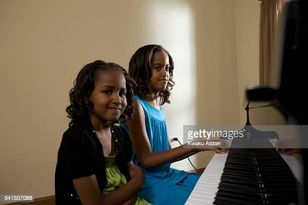 Malia Ann and Sasha Obama