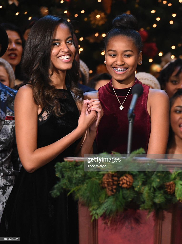 Malia Obama and Sasha Obama speak onstage at TNT Christmas in Washington 2014 at the National Building Museum on December 14, 2014 in Washington, DC. 25248_001_0582.JPG