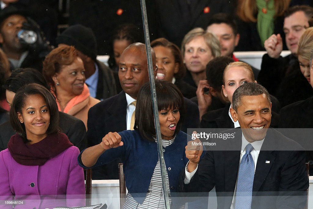 Malia Obama, First lady Michelle Obama and U.S. President Barack Obama watch from the reviewing stand as the presidential inaugural parade winds through the nation's capital January 21, 2013 in Washington, DC. Barack Obama was re-elected for a second term as President of the United States.