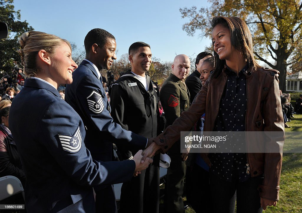Malia Obama (R) greets guests after the annual Thanksgiving turkey pardon November 21, 2012 at the Rose Garden of the White House in Washington, DC. Obama pardoned Cobbler and its alternate Gobbler, both raised in Rockingham County, Virginia. The turkeys will then spend the rest of the holiday season on display at George Washington's Mount Vernon estate. AFP PHOTO/Mandel NGAN