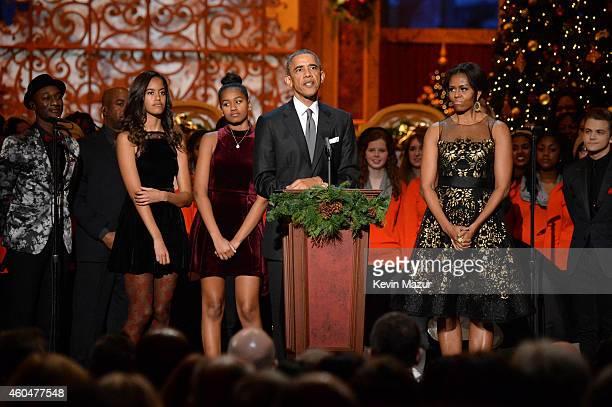 Malia Obama Sasha Obama Barack Obama and Michelle Obama pose onstage at TNT Christmas in Washington 2014 at the National Building Museum on December...