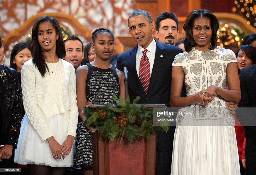 Malia Obama, Sasha Obama, US President Barack Obama, and First Lady Michelle Obama speak onstage at TNT Christmas in Washington 2013 at the National Building Museum on December 15, 2013 in Washington, DC. 24313_004_1423.JPG