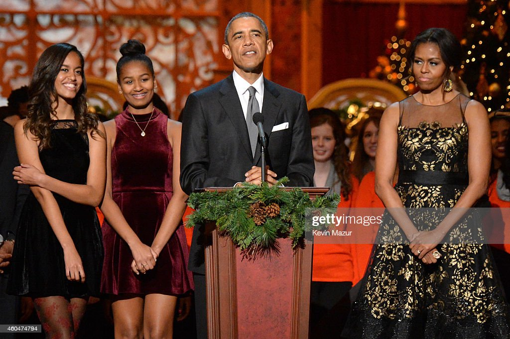 Malia Obama, Sasha Obama, U.S. President Barack Obama, and First Lady Michelle Obama speak onstage at TNT Christmas in Washington 2014 at the National Building Museum on December 14, 2014 in Washington, DC. 25248_002_1209.JPG