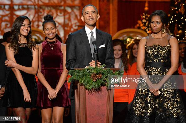 Malia Obama Sasha Obama US President Barack Obama and First Lady Michelle Obama speak onstage at TNT Christmas in Washington 2014 at the National...