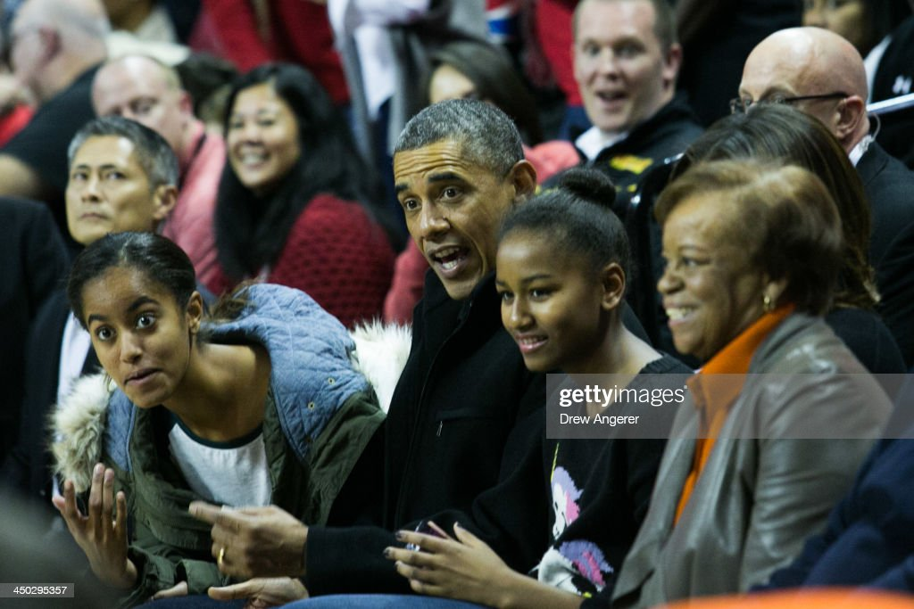 Malia Obama U S President Barack Obama Sasha Obama and Marian Robinson attend a men's NCCA basketball game between University of Maryland and Oregon...