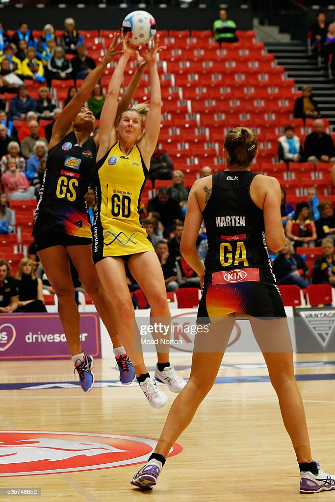 Malia Paseka of the BOP Magic challenging Katrina Grant of the Central Pulse during the round nine ANZ Championship match between the Magic and the Pulse at ASB Baypark Stadium on May 30, 2016 in Mount Maunganui, New Zealand.