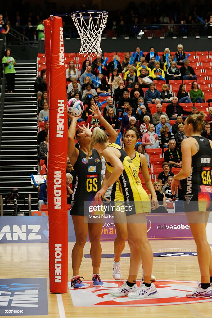 Malia Paseka of the BOP Magic shooting through Central Pulse defenders during the round nine ANZ Championship match between the Magic and the Pulse at ASB Baypark Stadium on May 30, 2016 in Mount Maunganui, New Zealand.