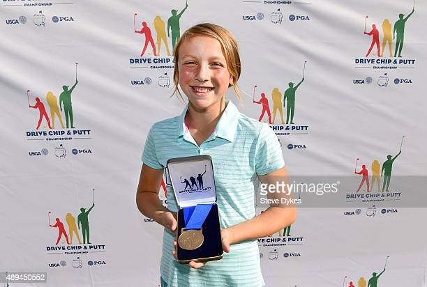 Malia Schroeder poses with her medal after winning the Putting competition the in the Girls 1213 yr old division during the Drive Chip and Putt...