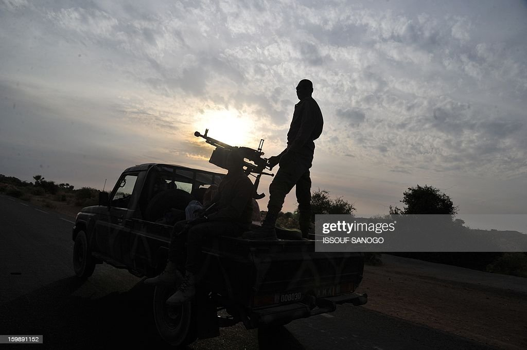 A Malian army armed pickup truck drives near Markala on on January 22, 2013. Italy said Tuesday it will send three planes to Mali to help support French and Malian troops battling Islamist rebels after parliament gave the green light for a two- to three-month logistical mission. AFP PHOTO / ISSOUF SANOGO