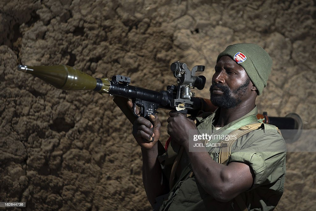 Malian army Brigadier Mamadou Coulibaly, aged 35, holds a rocket launcher on February 25, 2013 in Gao, some 1,200 kilometres (745 miles) north of Bamako. After recapturing the north's cities from the Al Qaeda groups that had controlled them since April 2012, the six-week-long French-led offensive took the fight to the retreating Islamist insurgents' toughest desert bastions.