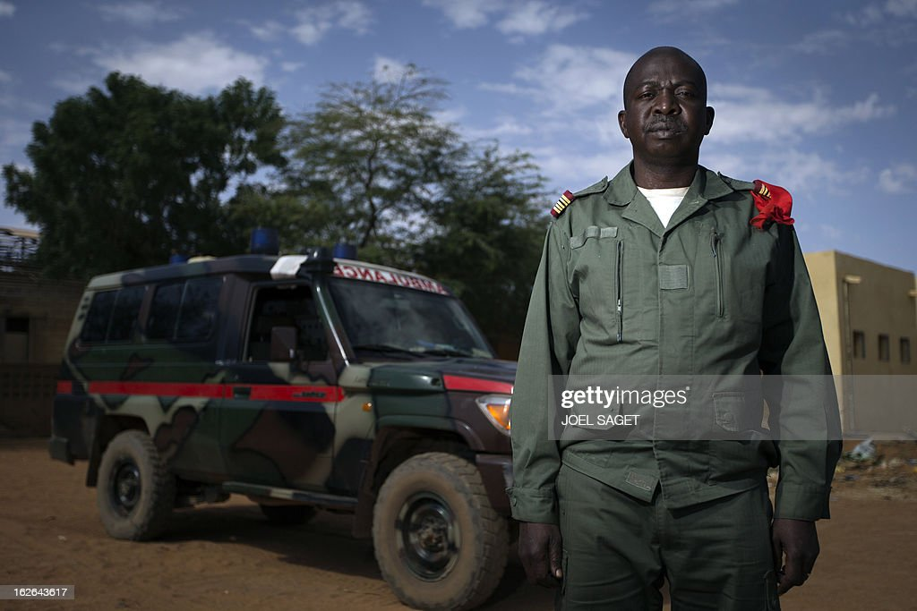 Malian army Colonel, doctor Madani Dembele, aged 48, poses on February 25, 2013 in Gao, some 1,200 kilometres (745 miles) north of Bamako. After recapturing the north's cities from the Al Qaeda groups that had controlled them since April 2012, the six-week-long French-led offensive took the fight to the retreating Islamist insurgents' toughest desert bastions.