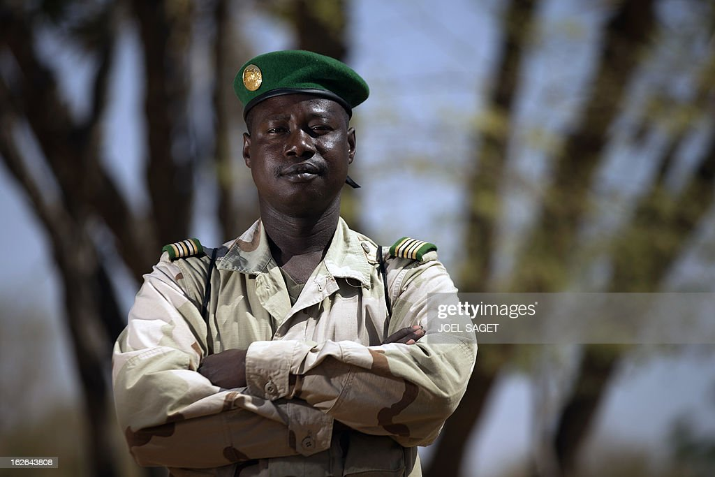 Malian army Colonel Mamadou Massaoule Samake, aged 42, poses on February 25, 2013 in Gao, some 1,200 kilometres (745 miles) north of Bamako. After recapturing the north's cities from the Al Qaeda groups that had controlled them since April 2012, the six-week-long French-led offensive took the fight to the retreating Islamist insurgents' toughest desert bastions. AFP PHOTO / JOEL SAGET