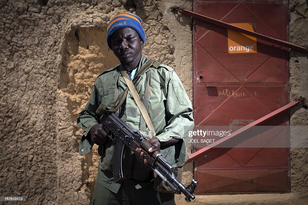Malian army Corporal Nouhoum Maiga, aged 35, holds an AK-47 assault rifle on February 25, 2013 in Gao, some 1,200 kilometres (745 miles) north of Bamako. After recapturing the north's cities from the Al Qaeda groups that had controlled them since April 2012, the six-week-long French-led offensive took the fight to the retreating Islamist insurgents' toughest desert bastions.