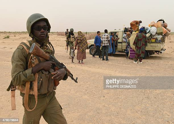 Malian army forces control a civilian vehicle on a pist on June 4 near Goundam 80 km east of Timbuktu central Mali as they patrol during a joint...