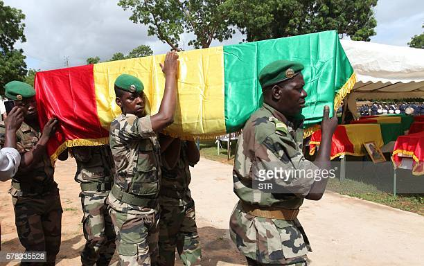 Malian army officers carry a coffin on July 21 2016 in Segou during a funeral ceremony At least 17 soldiers were killed in central Mali on July 19 in...