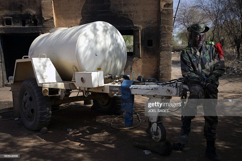 Malian army Sergeant N'koba Traore, aged 36, sits on February 25, 2013 in Gao, some 1,200 kilometres (745 miles) north of Bamako. After recapturing the north's cities from the Al Qaeda groups that had controlled them since April 2012, the six-week-long French-led offensive took the fight to the retreating Islamist insurgents' toughest desert bastions.