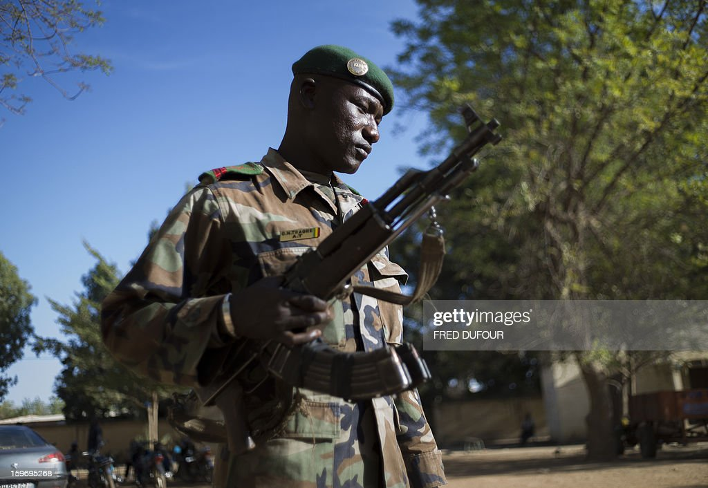 A Malian army soldier stands guard at the city hall in Niono, on January 18, 2013. France now has 1,800 troops on the ground in Mali, inching closer to the goal of 2,500 it plans to deploy in its African former colony, Defence Minister Jean-Yves Le Drian said today. That was 400 more than a day earlier, said the minister as he met with French special forces in the western port of Lorient. The troops have been sent to help the Malian army regain control of the north from Islamist groups.