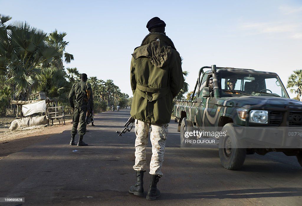 Malian army soldiers control a vehicule at a checkpoint in Niono, on January 18, 2013. France now has 1,800 troops on the ground in Mali, inching closer to the goal of 2,500 it plans to deploy in its African former colony, Defence Minister Jean-Yves Le Drian said today. That was 400 more than a day earlier, said the minister as he met with French special forces in the western port of Lorient. The troops have been sent to help the Malian army regain control of the north from Islamist groups.
