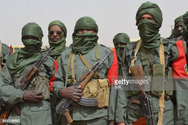 Malian army soldiers progovernment militia members and former rebels predominantly Tuaregs take part in their first joint patrol in Gao in northern...