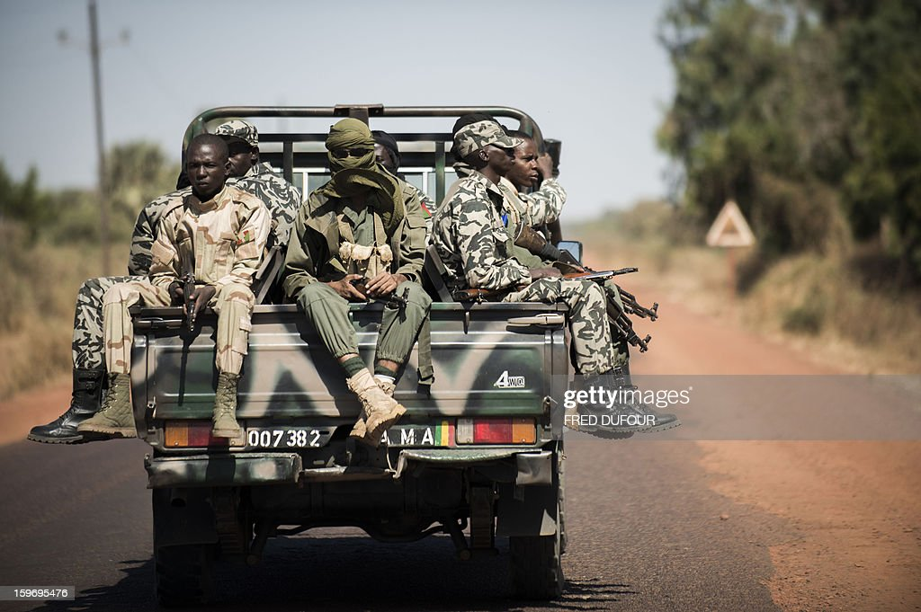 Malian army soldiers sit at the back of a pickup truck as they head towards Niono, on January 18, 2013. France now has 1,800 troops on the ground in Mali, inching closer to the goal of 2,500 it plans to deploy in its African former colony, Defence Minister Jean-Yves Le Drian said today. That was 400 more than a day earlier, said the minister as he met with French special forces in the western port of Lorient. The troops have been sent to help the Malian army regain control of the north from Islamist groups.
