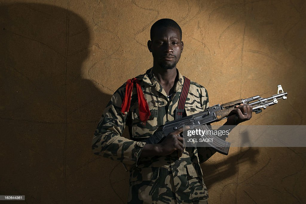 Malian army third-class private Brahima Camara, aged 28, poses with an AK-47 assault rifle on February 25, 2013 in Gao, some 1,200 kilometres (745 miles) north of Bamako. After recapturing the north's cities from the Al Qaeda groups that had controlled them since April 2012, the six-week-long French-led offensive took the fight to the retreating Islamist insurgents' toughest desert bastions.